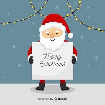 Santa claus trzyma szyldowego tło