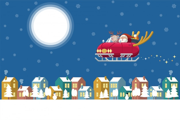 Santa latający sanie samochód nad zimy miasteczkiem przy nocą