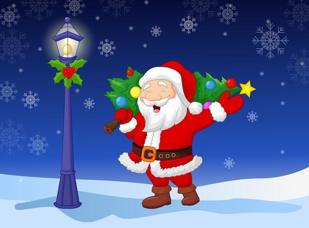 Santa niosący choinkę