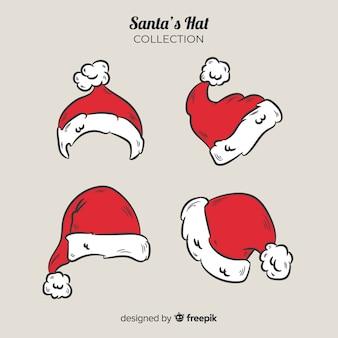Santa's hat boże narodzenie kolekcja w stylu wyciągnąć rękę