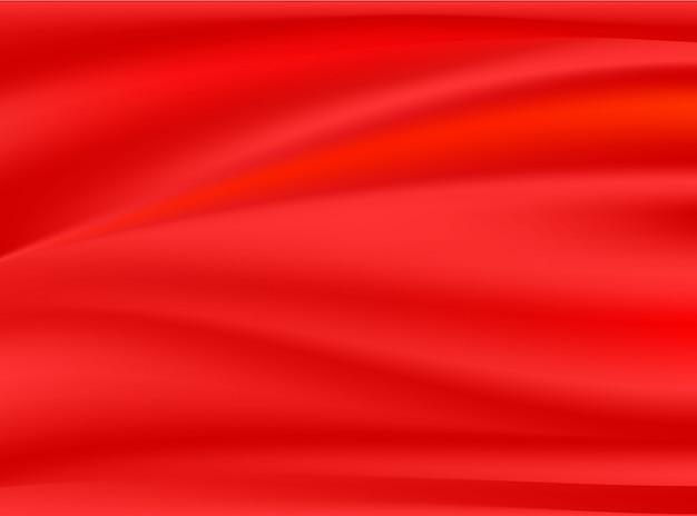 Satynowa czerwona sukienna tkanina odizolowywająca na pojęcie projekta tło