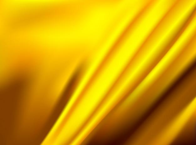 Satynowa złota sukienna tkanina odizolowywająca na pojęcie projekta tło