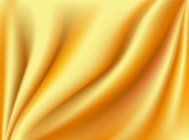 Satynowe złote i jedwabne tkaniny marszczą się na tle koncepcji projektu