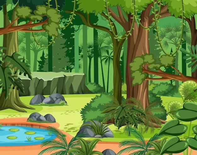 Scena dżungli z lianą i wieloma drzewami
