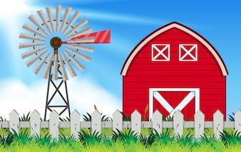 Scena gospodarstwa z wiatrak i stodole