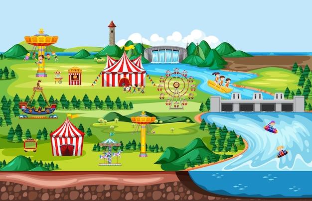 Scena krajobrazowego parku rozrywki i wiele przejażdżek ze szczęśliwymi dziećmi