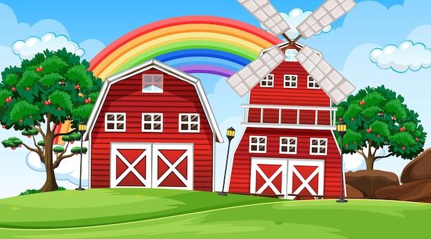 Scena krajobrazu rolniczego ze stodołą i wiatrakiem