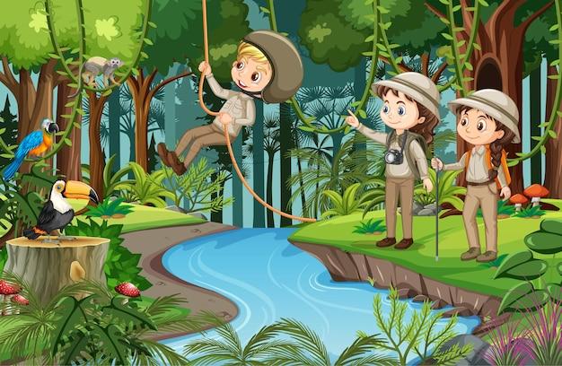 Scena leśna z wieloma dziećmi wykonującymi różne czynności