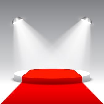 Scena na ceremonię wręczenia nagród z reflektorami. białe okrągłe podium z czerwonym dywanem. piedestał. scena. ilustracja.