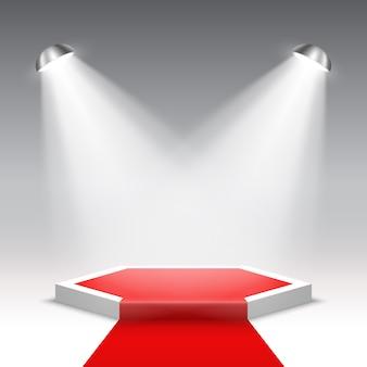 Scena na ceremonię wręczenia nagród z reflektorami. białe podium z czerwonym dywanem. piedestał. scena sześciokątna. .