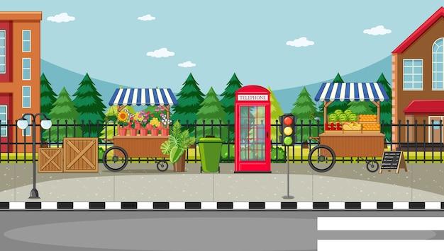 Scena od strony ulicy z wózkiem na kwiaty i wózkiem z owocami