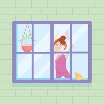 Scena okna domu przedstawiająca dziewczynę robi joga