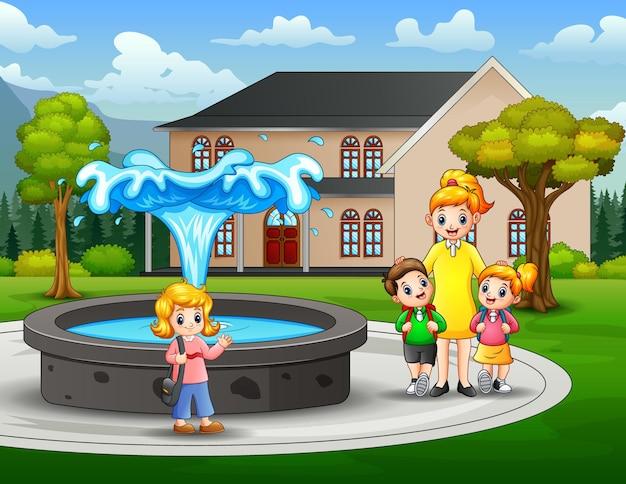 Scena parkowa z dziećmi w wieku szkolnym i nauczycielką