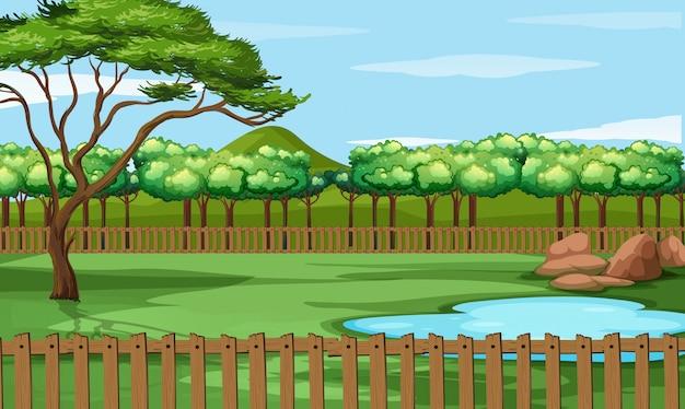 Scena parku ze stawem i drzewami