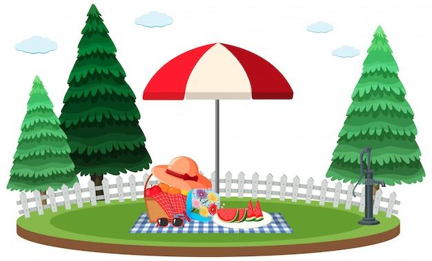 Scena piknikowa ze świeżymi owocami w koszu