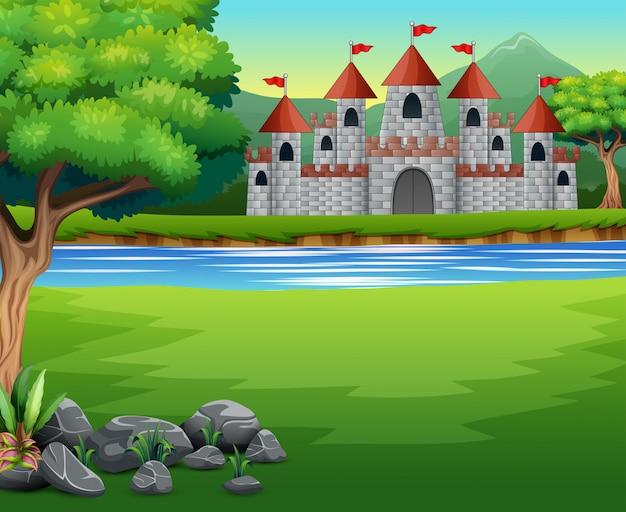Scena przyrody z zamkiem i stawem