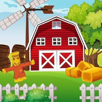 Scena rolnicza w naturze z stodołą i strach na wróble