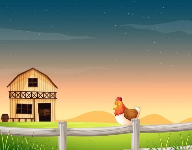 Scena rolnicza w naturze ze stodołą i kurczakiem