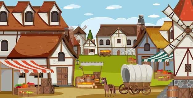 Scena średniowiecznej wioski z wiatrakiem i domami