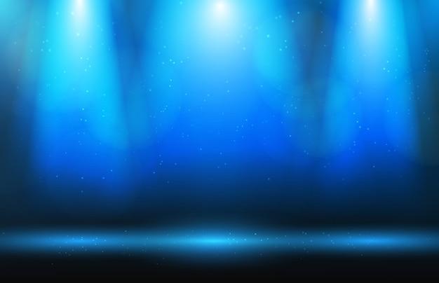 Scena, światło reflektorów i kurz na niebieskim tle