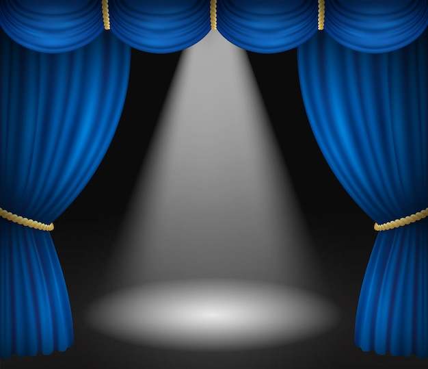 Scena teatralna z niebieskimi zasłonami i reflektorem