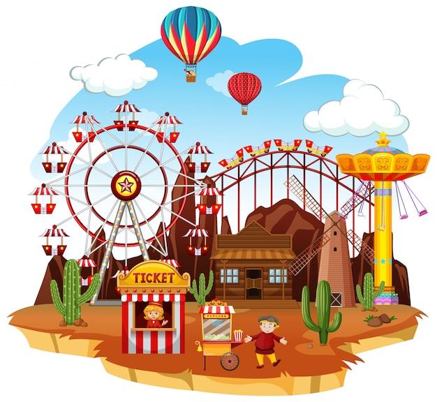 Scena themepark z wieloma przejażdżkami i balonami