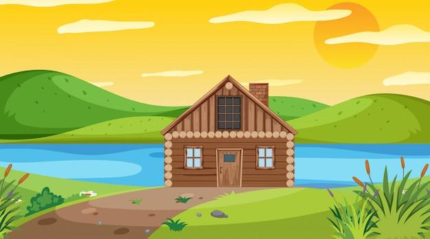 Scena z drewnianą chałupą w polu