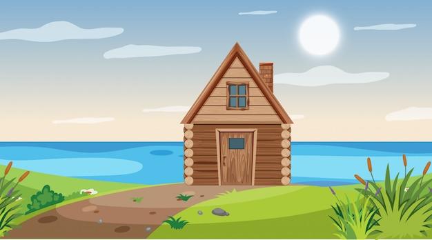 Scena z drewnianą chatą nad jeziorem