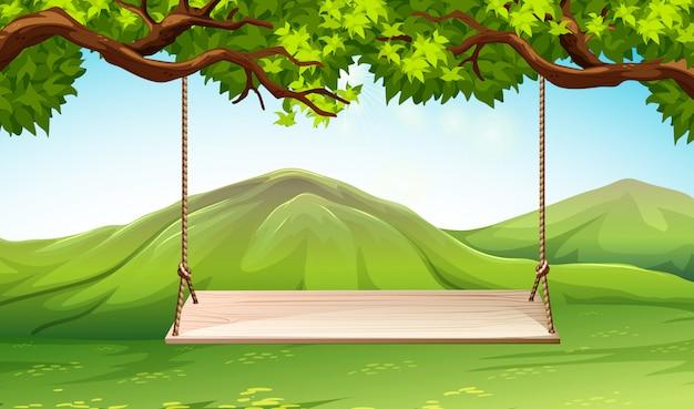 Scena z drewnianą huśtawką w parku