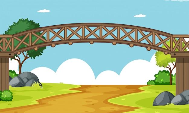 Scena z drewnianym mostem