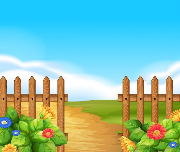 Scena z drewnianym ogrodzeniem i polem