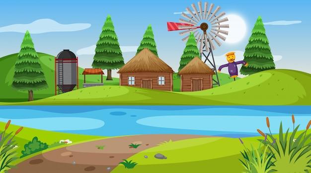 Scena z drewnianymi chatami i silosem nad wzgórzami