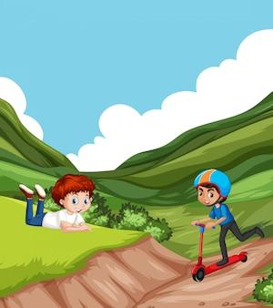 Scena z dwoma chłopcami bawiącymi się w parku