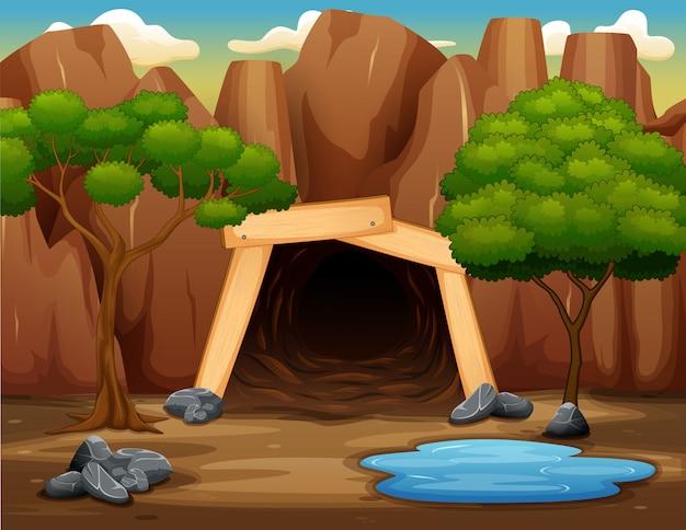 Scena z kopalnianym wejściem na skalistej górze