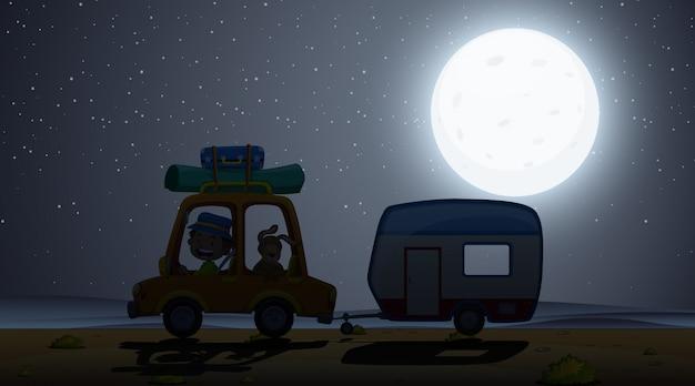 Scena z mężczyzną jazdy z psem w nocy