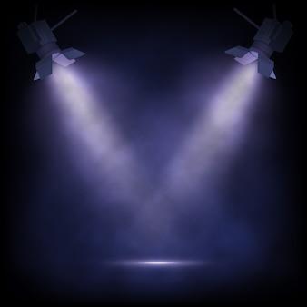 Scena z reflektorami, niebieskim tłem teatralnym lub spektaklem.