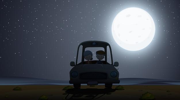 Scena z sylwetką ludzi jadących nocą