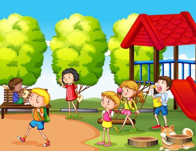Scena z wieloma dziećmi bawiącymi się w parku