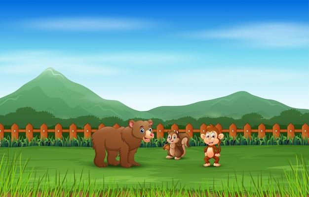 Scena z wieloma zwierzętami w zielonym polu
