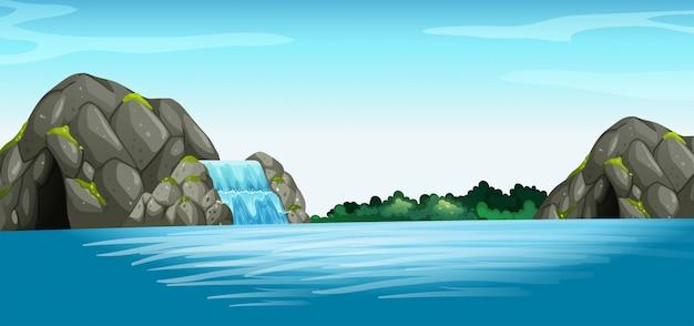 Scena z wodospadem i jaskini