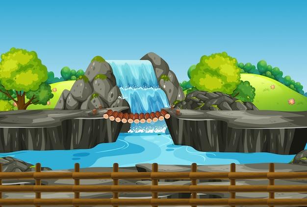 Scena z wodospadem i trawą