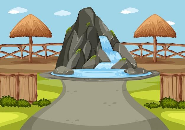 Scena z wodospadem na środku parku