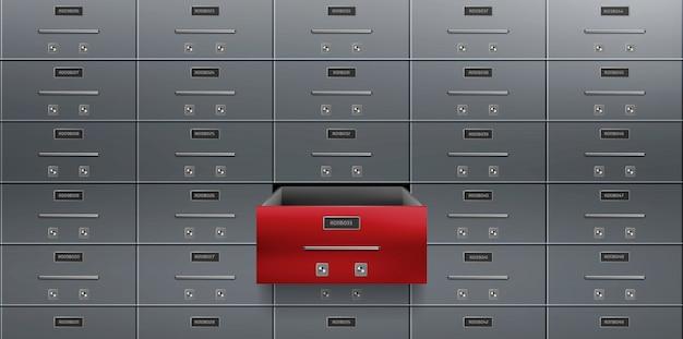 Sejfy depozytowe na ścianie zamykają jedną czerwoną szafkę