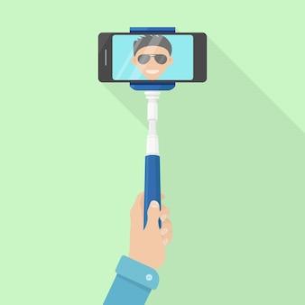 Selfie przez telefon za pomocą kijka do selfie