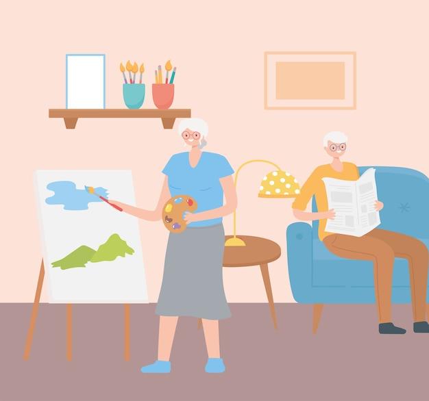 Seniorzy aktywnie spędzający czas, starsza para w pokoju czytająca gazetę i malująca na płótnie