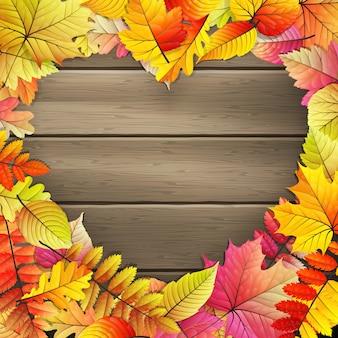 Serce z kolorowych liści jesienią.