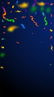 Serpentyny i konfetti. kolorowe serpentyny ze świecidełkami i wstążkami z folii. konfetti padający deszcz na ciemnym niebieskim tle.