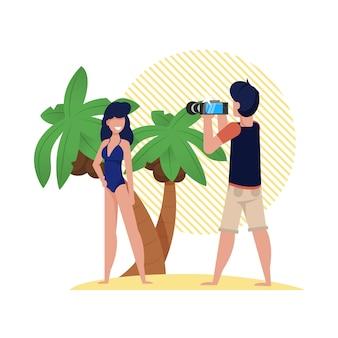 Sesja zdjęciowa na plaży z palmami, rysunek. dziewczyna w kostiumie kąpielowym stojący na wybrzeżu i pozowanie przed kamerą.