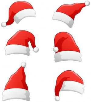 Set bożych narodzeń święty mikołaj kapelusze odizolowywający na bielu