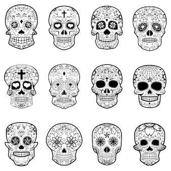 Set cukrowe czaszki odizolowywać na białym tle. dzień śmierci.